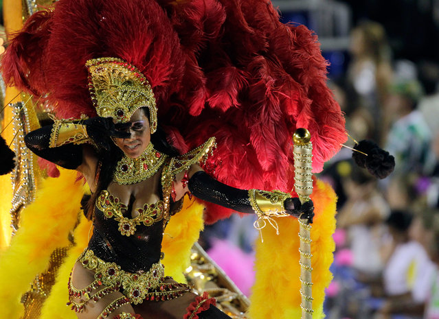 A reveller from the Sao Clemente samba school takes part in a parade on the second night of the annual Carnival parade in Rio de Janeiro's Sambadrome, on February 20, 2012