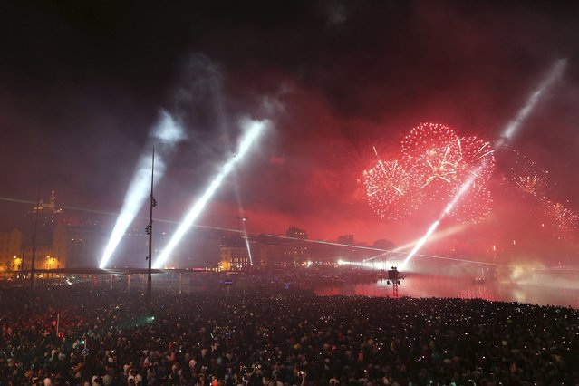Fireworks light up the sky near the Old Port as part of the end of the traditional Bastille Day celebrations in Marseille, July 14, 2014. (Photo by Philippe Laurenson/Reuters)