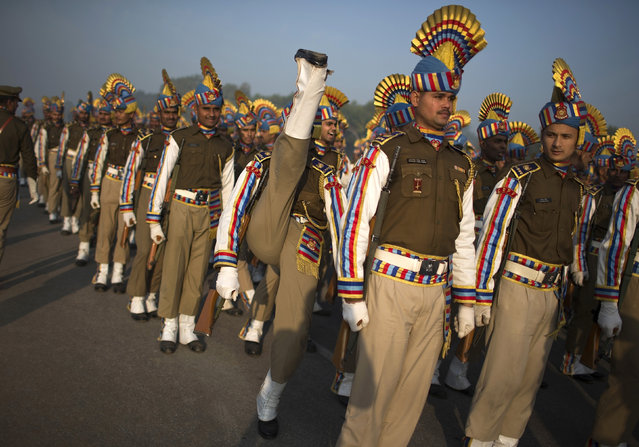 India's Central Reserve Police Force personnel take part in a rehearsal for the Republic Day parade on a cold winter morning in New Delhi January 8, 2014. (Photo by Ahmad Masood/Reuters)