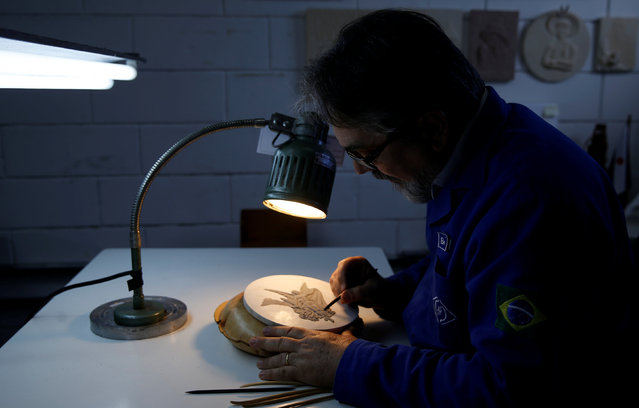 Nelson Carneiro, craftsman from the Casa da Moeda do Brasil (Brazilian Mint) works on the Rio 2016 Olympic medal mold in Rio de Janeiro, Brazil, June 28, 2016. (Photo by Sergio Moraes/Reuters)