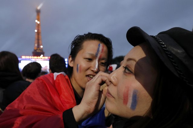 France fans prepare in the fan zone near the Eiffel Tower during the France v Iceland EURO 2016 quarter final soccer match in the fan zone in Paris, France, July 3, 2016. (Photo by Philippe Wojazer/Reuters)