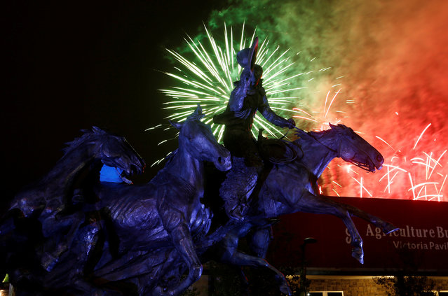Fireworks go off behind a bronze horse and rider sculpture during the Calgary Stampede in Calgary, Alberta, Canada July 14, 2016. (Photo by Todd Korol/Reuters)