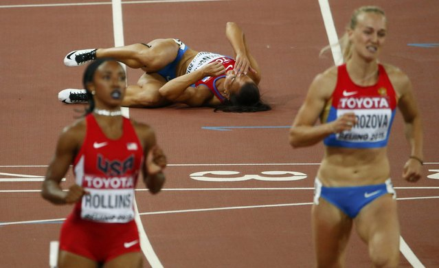 Andrea Ivancevic of Croatia lays on the ground after tripping on a hurdle in the women's 100 metres hurdles semi-final during the 15th IAAF World Championships at the National Stadium in Beijing, China August 28, 2015. (Photo by David Gray/Reuters)