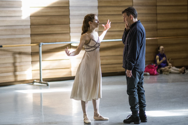 In this Tuesday, September 12, 2017 photo, Director Julio Bocca instructs principal ballet dancer Maria Noel Riccetto during rehearsal for Romeo and Juliet in Montevideo, Uruguay. Bocca recently announced that he would be stepping down as director of Uruguay's National ballet of the Sodre but that he will continue to live in Uruguay and will focus fully on teaching the company and completing his dream of turning it into one of the best in the world. (Photo by Matilde Campodonico/AP Photo)