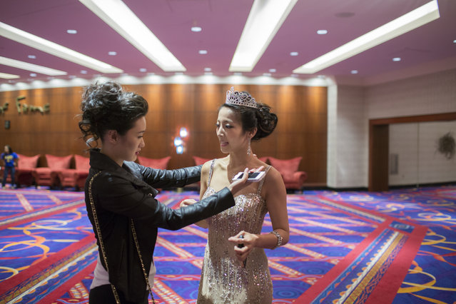 "Image consultant Danni Wang, left, talks before the show with Michelle Kaszuba, the pageant's 1st runner up in 2013, who will present the 2014 runner up with a tiara. MNYCBP's 2013 First Runner Up, Michelle Sun, said, ""The biggest thing this pageant has helped me with is my confidence. I've seen many girls go through the same transformation"". (Photo and caption by John Brecher/Sahra Vang Nguyen/NBC News)"