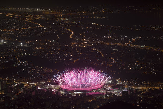 Fireworks explode over Maracana Stadium during the opening ceremony at the 2016 Summer Olympics in Rio de Janeiro, Brazil, Friday, August 5, 2016. (Photo by Felipe Dana/AP Photo)