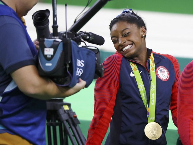 2016 Rio Olympics, Artistic Gymnastics, Final, Women's Individual All-Around Final, Rio Olympic Arena, Rio de Janeiro, Brazil on August 11, 2016. Simone Biles (USA) of USA, wearing her gold medal, reacts at a camera after winning the women's individual all-around final. (Photo by Mike Blake/Reuters)
