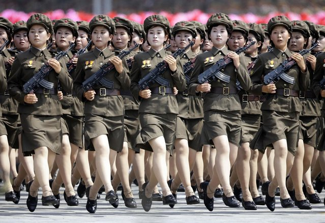 North Korean soldiers parade to mark the 60th anniversary of the signing of a truce in the 1950-1953 Korean War at Kim Il-sung Square, in Pyongyang July 27, 2013. (Photo by Jason Lee/Reuters)