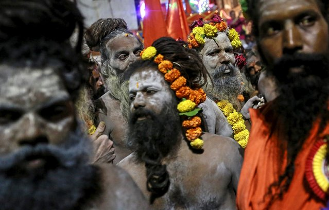 "Naga Sadhus, or Hindu holy men, attend a procession before taking a dip in a holy pond during the second ""Shahi Snan"" (grand bath) at ""Kumbh Mela"", or Pitcher Festival, in Trimbakeshwar, India, September 13, 2015. (Photo by Danish Siddiqui/Reuters)"