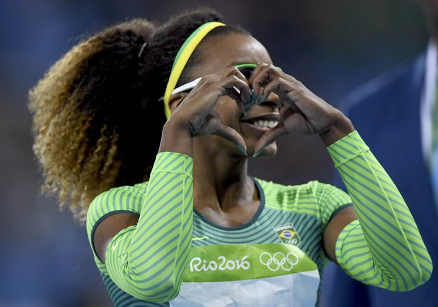 2016 Rio Olympics, Athletics, Preliminary, Women's 100m Round 1, Olympic Stadium, Rio de Janeiro, Brazil on August 12, 2016. Rosangela Santos (BRA) of Brazil reacts. (Photo by Dylan Martinez/Reuters)