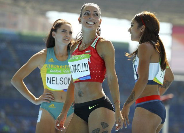2016 Rio Olympics, Athletics, Preliminary, Women's 200m Round 1, Olympic Stadium, Rio de Janeiro, Brazil on August 15, 2016. Ella Nelson (AUS) of Australia, Ivet Lalova-Collio (BUL) of Bulgaria and Jodie Williams (GBR) of Britain stand together. (Photo by Lucy Nicholson/Reuters)