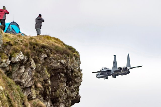 Enthusiasts gathered at Cad East in Snowdonia National Park, England to take pictures of F-15 Eagle fighters as they completed the Mach Loop, November 2017. (Photo by Caters News Agency)