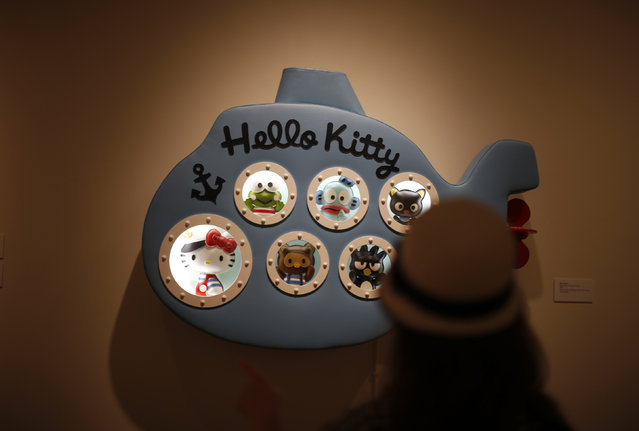"""Vivian Wolfson, 10, views an exhibit at the """"Hello! Exploring the Supercute World of Hello Kitty"""" museum exhibit in honor of Hello Kitty's 40th anniversary, at the Japanese American National Museum in Los Angeles, California October 10, 2014. (Photo by Lucy Nicholson/Reuters)"""