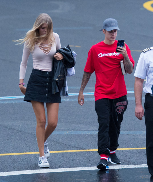 Justin Bieber and model Bronte Blampied boarded a private helicopter to fly to V Festival in London on August 21, 2016. (Photo by D. Wieland/Splash News)