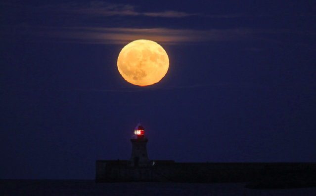The Winter Supermoon rises over the Lighthouse at South Shields, Tyne & Wear on December 3, 2017. (Photo by Owen Humphreys/PA Images via Getty Images)