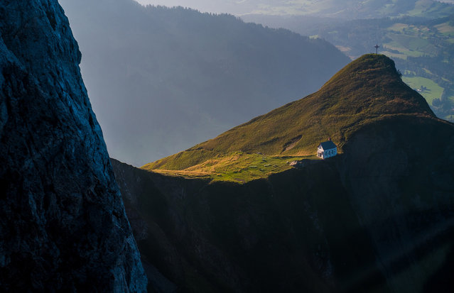 """Chapel on Klimsenhorn: I took this picture while I was in an aerial cableway going down from the Mt. Pilatus in Central Switzerland. It was the end of a nice day spent hiking, including a stop by the beautiful little white chapel on Klimsenhorn on the way to the top"". (Photo and comment by Agne Subelyte/National Geographic Photo Contest via The Atlantic)"