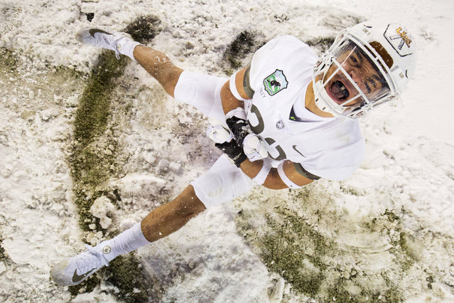 Army Black Knights defensive back Elijah Riley (23) celebrates in the snow after a victory against the Navy Midshipmen in the the 118th Army Navy game at Lincoln Financial Field in Philadelphia, PA, USA on December 9, 2017. (Photo by Bill Streicher/USA TODAY Sports)