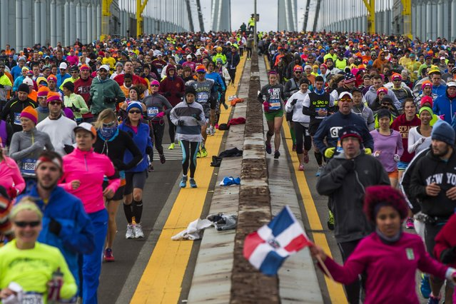 Runners cross the Verrazano-Narrows Bridge shortly after the start of the New York City Marathon in New York, November 2, 2014. (Photo by Lucas Jackson/Reuters)