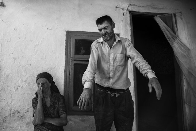 """""""Harpena and his husband"""". Harpena, a woman of the last village in the Danube.. a lifetime of poverty, of violence by marito.. Ma although this goes on in our heads held high, draped with a great humility. Photo location: Romania. (Photo and caption by Catalina Filip/National Geographic Photo Contest)"""