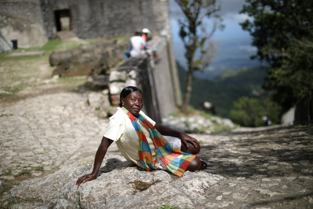 A vendor waits for visitors to arrive to the Citadel Laferriere in Milot, Haiti, on November 19, 2017. The Citadel Laferriere is one of the main touristic attractions in Haiti and it is considered a World Heritage Site according to UNESCO. (Photo by Andres Martinez Casares/AP Photo)