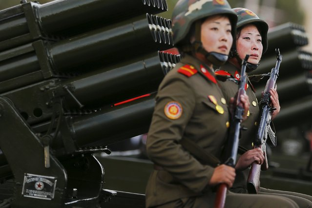 A soldier (R) cries as her vehicle with rocket launchers drives past a stand with North Korean leader Kim Jong Un during the parade celebrating the 70th anniversary of the founding of the ruling Workers' Party of Korea, in Pyongyang October 10, 2015. (Photo by Damir Sagolj/Reuters)
