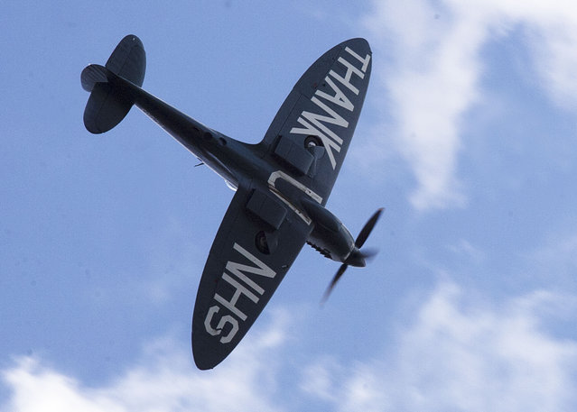"""NHS 72nd anniversary Super Marine Spitfire PR.X1 ( PL983 ) belonging to the Aircraft Restoration Company based at UK Imperial War Museum Duxford in cambridgeshire flies over Lister hospital in Stevenage, Hertfordshire on July 5, 2020 with the words """"THANK U NHS"""" on the underside. (Photo byAirpix/Rex Features/Shutterstock)"""