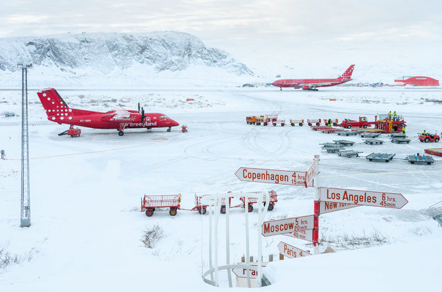 Spirit of Travel: Andy Holliman (UK) – Kangerlussuaq airport, Greenland. This is the largest airport in Greenland, so it's not only a busy hub for domestic flights but also the main arrival point for international travellers. Air Greenland has a near monopoly on flights, so almost everything is in the company's colours. It was the simple colour palette of this scene that appealed to me. My departure had been delayed by three days due to bad weather on the coast. (Photo by Andy Holliman/The Outdoor Photographer of the Year/The Guardian)