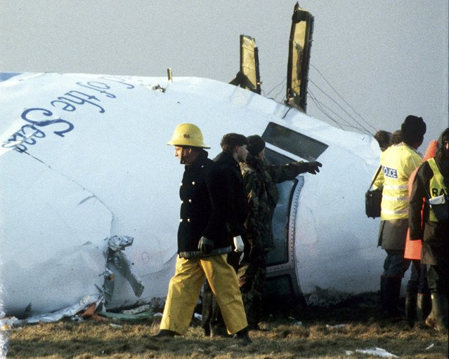 A December 23, 1988 file photo shows Scottish rescue workers and crash investigators search the area around the cockpit of Pan Am flight 103 in a farmer's field east of Lockerbie, Scotland. Scottish and U.S. investigators have identified two Libyan suspects believed to have been involved in the 1988 Lockerbie airline bombing which killed 270 people, Scottish prosecutors said on Thursday. (Photo by Greg Bos/Reuters)