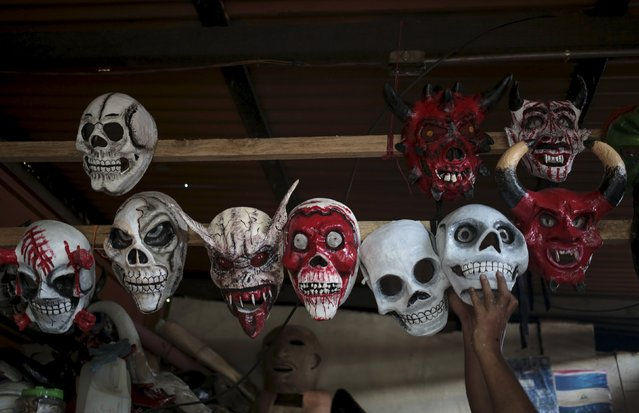 Masks are displayed for sale prior to the Los Aguizotes festival in the indigenous community of Monimbo in Masaya, Nicaragua, October 16, 2015. (Photo by Oswaldo Rivas/Reuters)