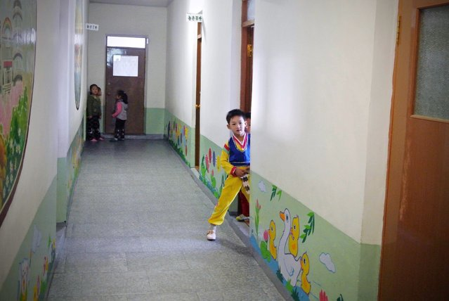A North Korean boy looks on as he prepares for a music drill at a nursery school  in the northeastern North Korean border town of Sinuiju on December 15, 2012. (Photo by Wang Zhao/AFP Photo)