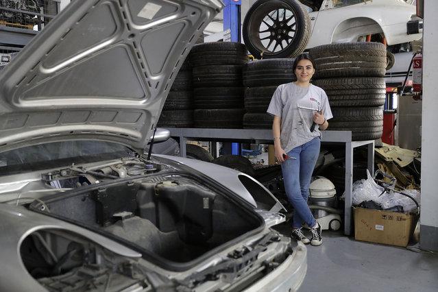 Lebanese mechanic Rana el-Hayek, 22, poses in a car repair garage where she works in Qannabat Brummana, northeast of Beirut on March 3, 2018. (Photo by Joseph Eid/AFP Photo)