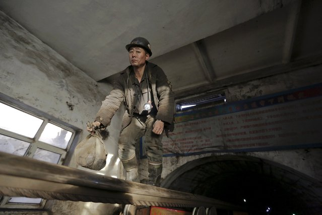 A miner comes out of a mine on a transmission band at a coal mine from the state-owned Longmay Group on the outskirts of Jixi, in Heilongjiang province, China, October 22, 2015. (Photo by Jason Lee/Reuters)