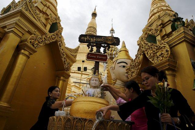 People pray at Shwedagon Pagoda in Yangon, Myanmar, November 10, 2015. (Photo by Jorge Silva/Reuters)