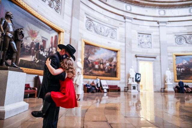 Representative-elect Troy Nehls (R-TX) hugs his daughter Tori Nehls in the U.S. Capitol in Washington, DC, U.S., January 3, 2021. (Photo by Tasos Katopodis/Pool via Reuters)