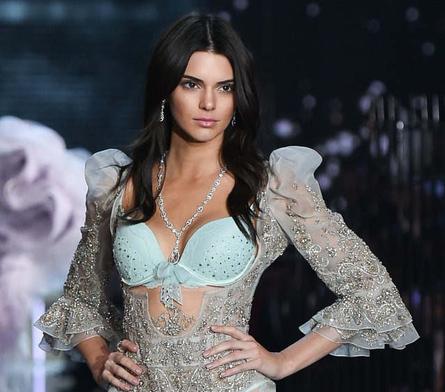 In this November 10, 2015, file photo, model Kendall Jenner walks the runway during the 2015 Victoria's Secret Fashion Show at the Lexington Armory in New York. An image of model and reality TV star Jenner posing with her hair forming several heart shapes was the year's most liked photo on Instagram. The image has been liked more than 2.3 million times since it was posted in July 2015. (Photo by Evan Agostini/Invision/AP Photo)