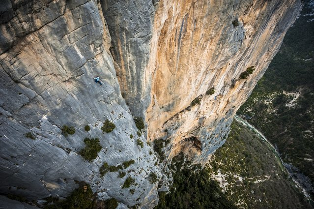 """Freesolo"". Austrian athlete Mich Kemeter climbs the 300m high Verdon cliffs without a rope or any safety equipment, here on the last pitch of the Durandal route (F6a/5.10a). Location: Verdon Gorges, France. (Photo and caption by Alexandre Buisse/National Geographic Traveler Photo Contest)"