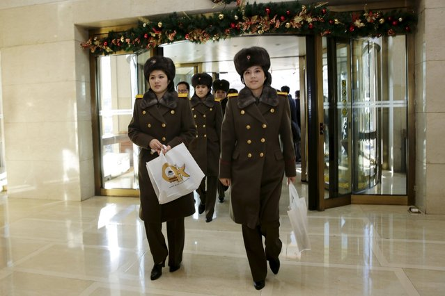 Members of the Moranbong Band from North Korea walk in an entrance of a hotel in central Beijing, China, December 11, 2015. (Photo by Reuters/Stringer)