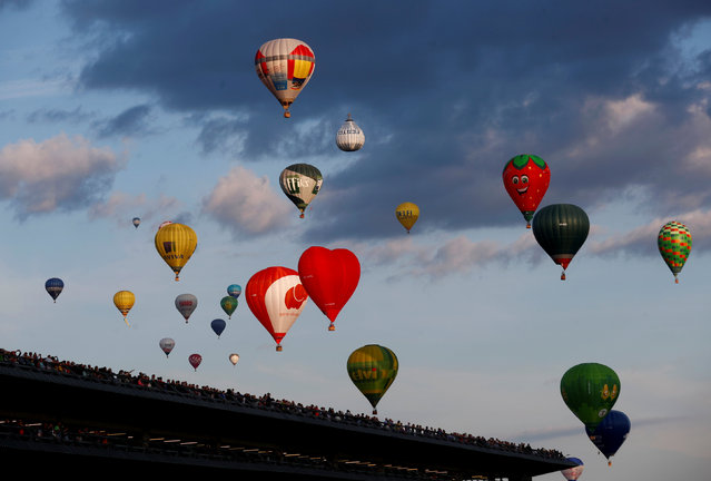 Hot air ballons take part in the Wind of Freedom 100 hot air balloon fiesta marking country's centenary of restoring of independence, in Kaunas, Lithuania July 7, 2018. (Photo by Ints Kalnins/Reuters)