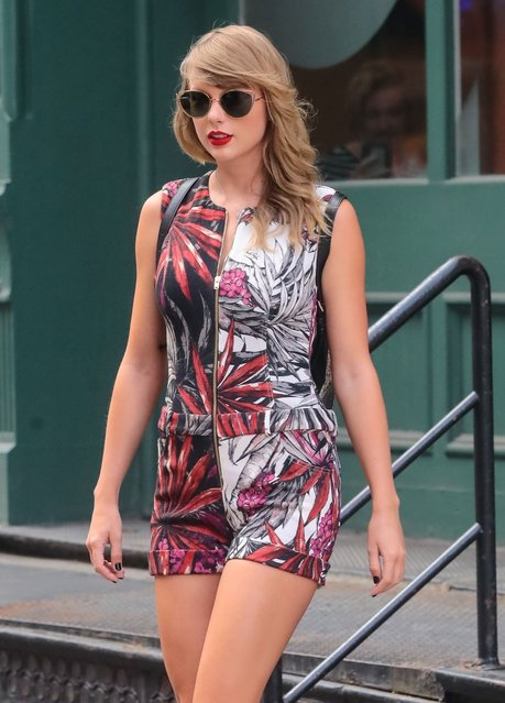 """Pop singer Taylor Swift is seen in New York City, New York on July 17, 2018. The """"Shake It Off"""" singer was spotted looking edgy and chic in a printed playsuit and platform boots. (Photo by Bauer-Griffin/Splash News and Pictures)"""