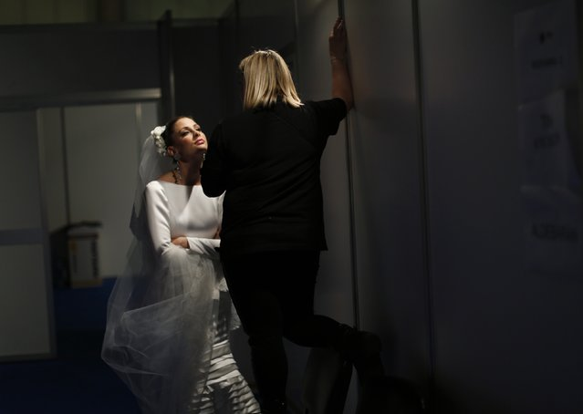 A model is seen backstage during the International Flamenco Fashion Show SIMOF in the Andalusian capital of Seville February 5, 2015. (Photo by Marcelo del Pozo/Reuters)