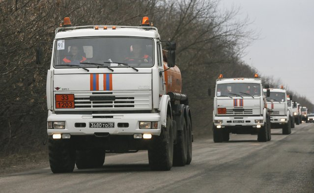 Fuel tank trucks of the Russian Emergencies Ministry, part of a Russian convoy of trucks carrying humanitarian aid, drive along a road outside the town of Ilovaisk, Donetsk region, February 8, 2015. (Photo by Maxim Shemetov/Reuters)