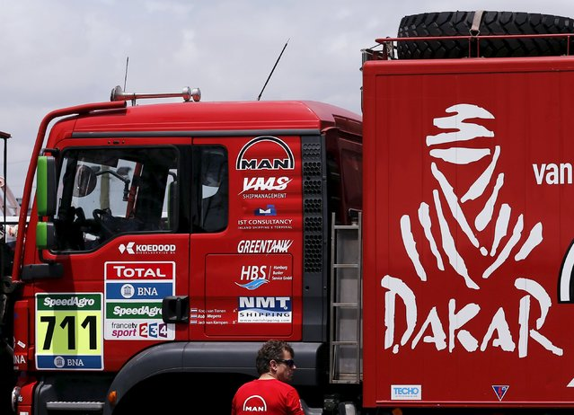 A man stands next to an official Dakar Rally assistance truck outside the technical verification area ahead of the Dakar Rally 2016 in Buenos Aires, Argentina, December 31, 2015. (Photo by Marcos Brindicci/Reuters)