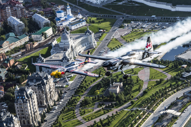 A handout photo made available by Limex Images of Pete McLeod of Canada (R) and Kirby Chambliss of the United States flying over the city of Kazan prior to the fifth stage of the Red Bull Air Race World Championship in Russia on August 22, 2018. (Photo by Joerg Mitter/EPA/EFE/Limex Images)