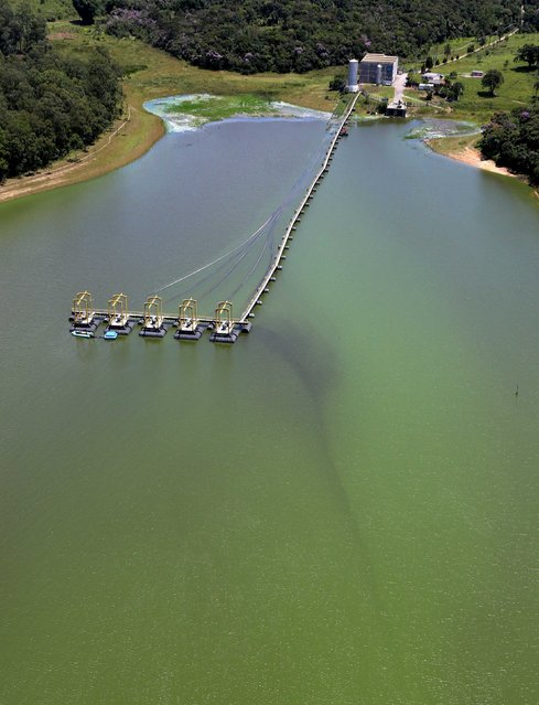 An aerial view of shows pumps used to transfer polluted water from the Billings reservoir to the Guarapiranga reservoir in Diadema February 12, 2015. According to local media, the Billings dam supplies 1.6 million people in the Greater ABC region of Greater Sao Paulo and the state government wants to treat the water to be adequate for human consumption, adding to the complexity of securing safe water supply during the drought. (Photo by Paulo Whitaker/Reuters)