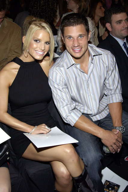 Jessica Simpson and Nick Lachey in Tommy Hilfiger during Mercedes-Benz Fashion Week Spring 2004 – Tommy Hilfiger – Front Row at Gertrude Tent, Bryant Park in New York City, New York, United States. (Photo by KMazur/WireImage for Tommy Hilfiger)
