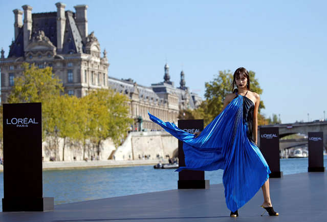 A model Luma Grothe presents a creation on a giant catwalk installed on a barge on the Seine River during a public event organized by French cosmetics group L'Oreal as part of Paris Fashion Week, France, September 30, 2018. (Photo by Stephane Mahe/Reuters)