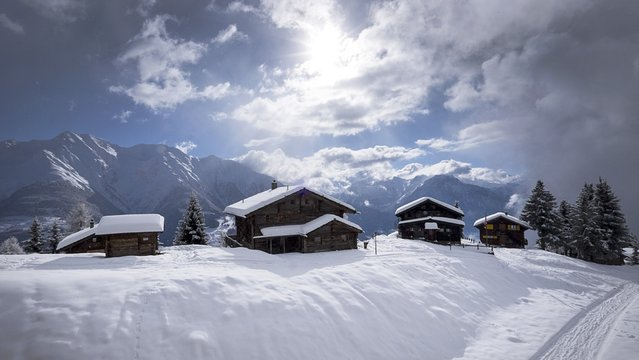 The sun breaks through the clouds at the snow covered Riederalp in the canton of Valais, southwestern Switzerland, Sunday, January 25, 2015. (Photo by Georgios Kefalas/AP Photo/Keystone)