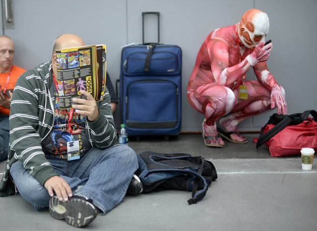 Fans in costume arrive for the opening session of the 2013 New York Comic Con at the Jacob Javits Center on October 10, 2013. The four day event which runs October 10–13 is the largest pop culture event on the East Coast. (Photo by Timothy Clary/AFP Photo)