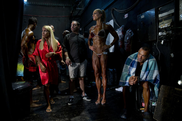 In this Thursday, October 18, 2018 photo, contestants wait for their performance backstage during the National Amateur Body Builders' Association competition in Tel Aviv, Israel. Just short of 80 contestants participated in 14 categories at this year's competition. (Photo by Oded Balilty/AP Photo)