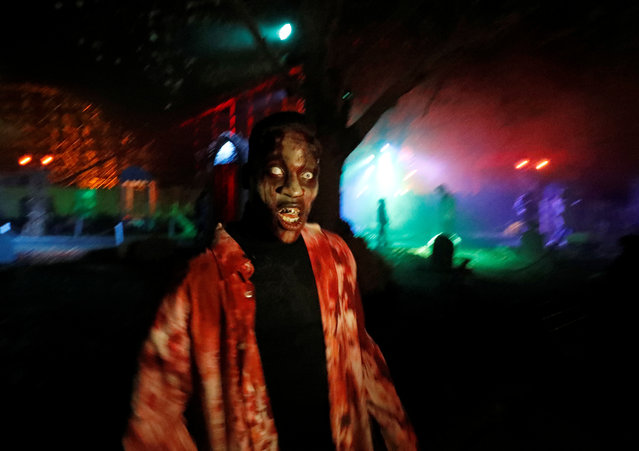 A participant in costume and make-up poses for a photo during a Halloween parade at Walibi park in Wavre, Belgium, October 31, 2018. (Photo by Yves Herman/Reuters)